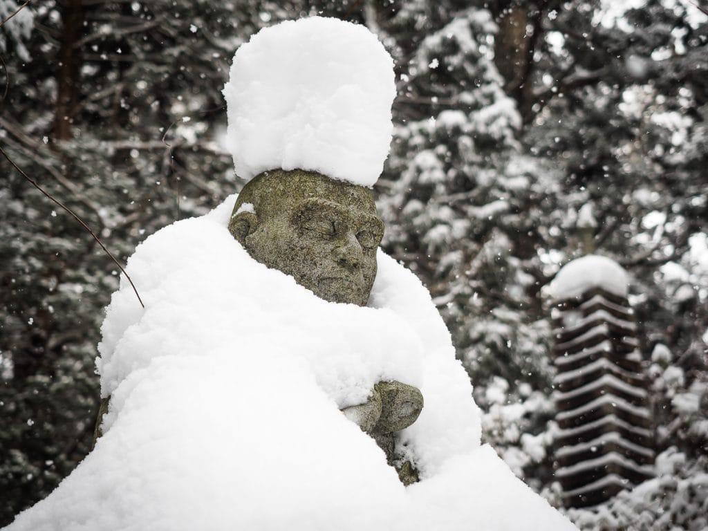 Snow topped Buddha in Okunoin cemetery, Koyasan
