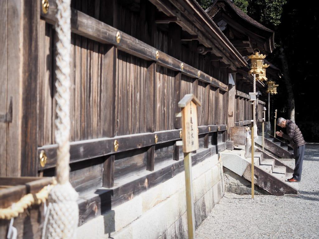 Praying in front of Kumano Hongu Taisha grand shrine, most important of the three Kumano Sanzan