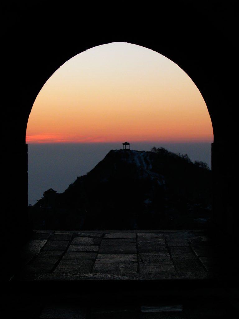 Taishan sunset through an arched doorway