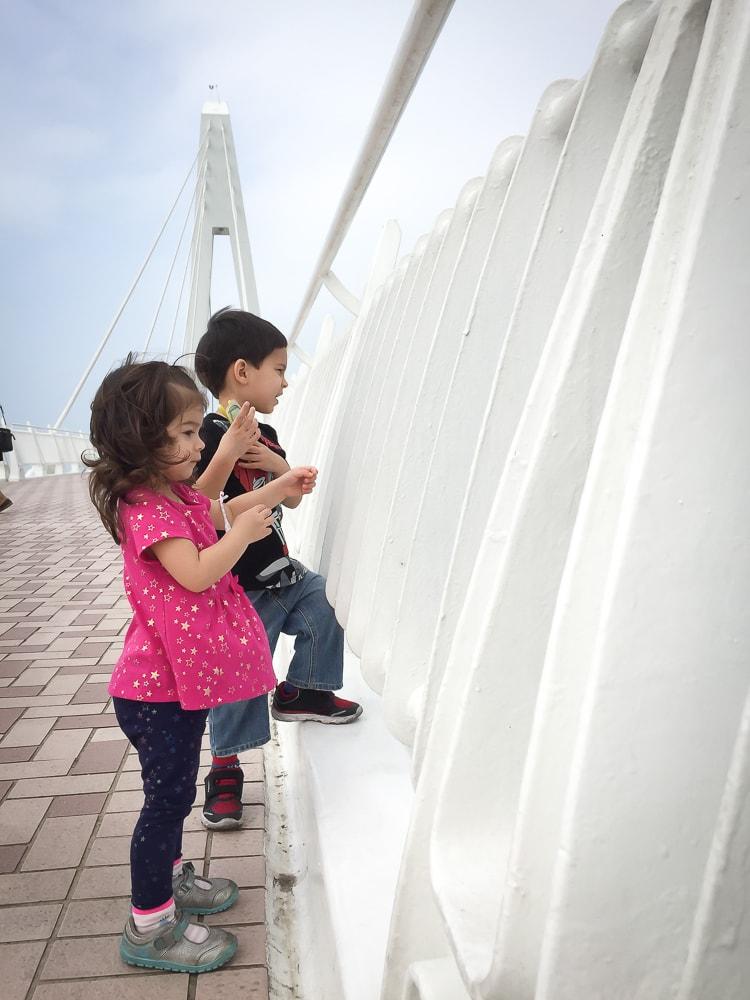 My kids on Lover's bridge, Fisherman's Wharf, Taipei