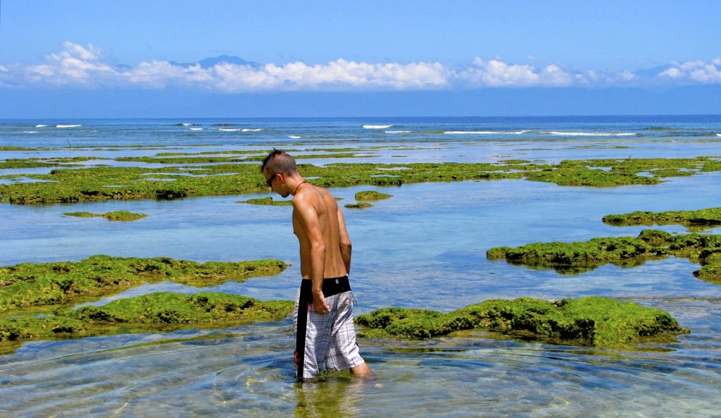 Me walking in some coastal pools of water at Green Islands, Taiwan in summer