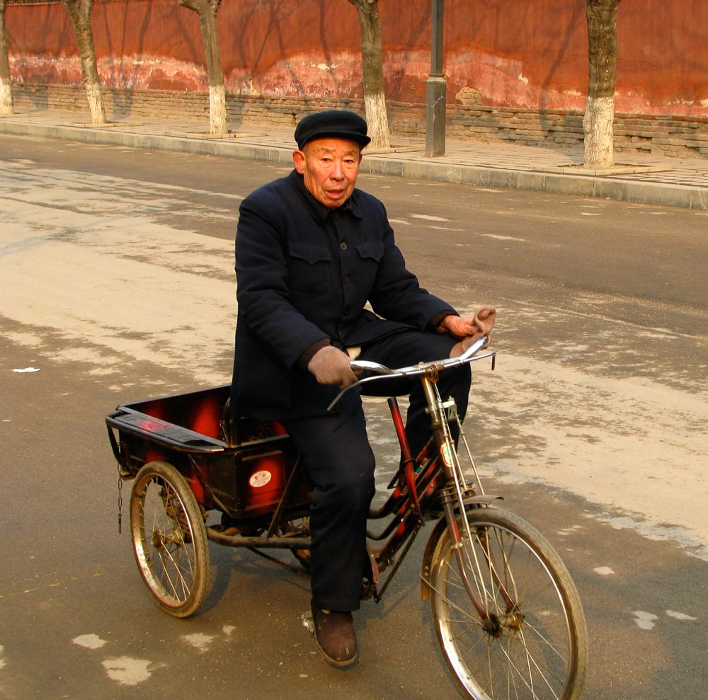 Elderly cyclist in the Qufu Old City, Shandong, China