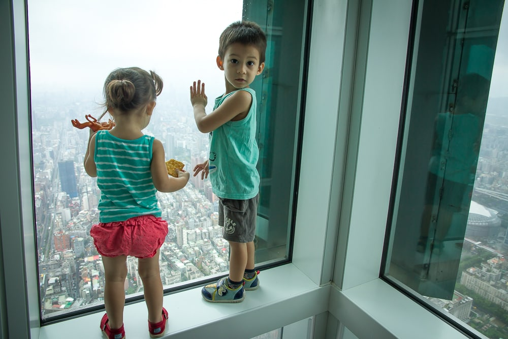 Taking my kids in the Taipei 101 Observatory