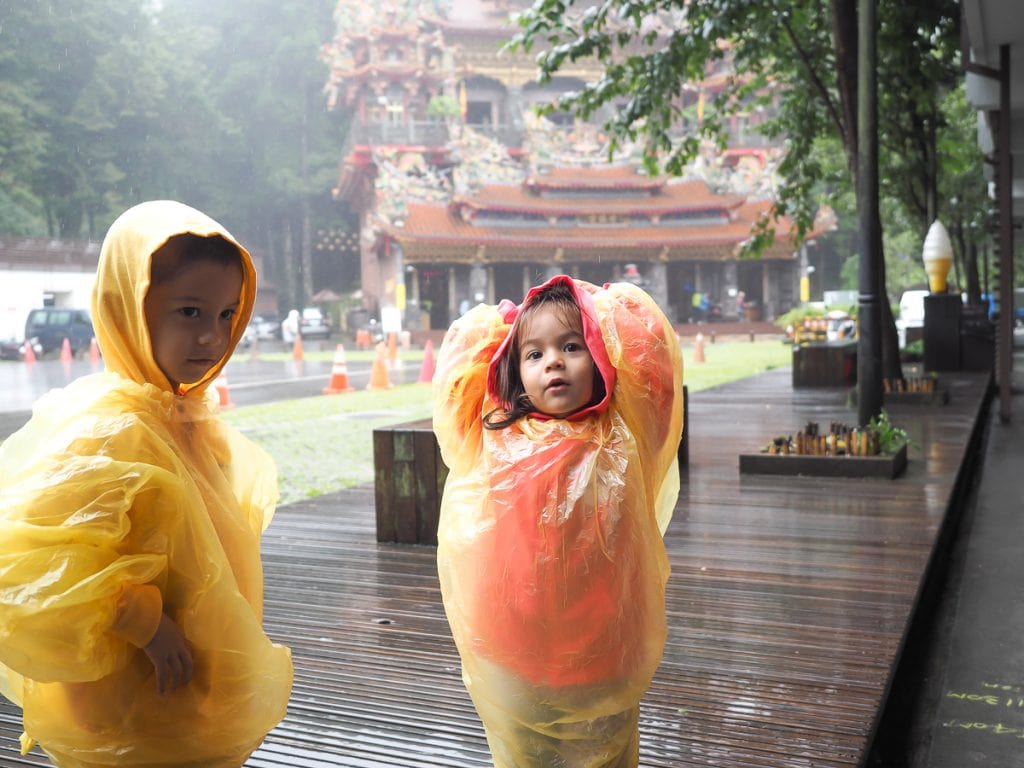 Getting some rain while hiking in Alishan, with Shouzhen temple behind.