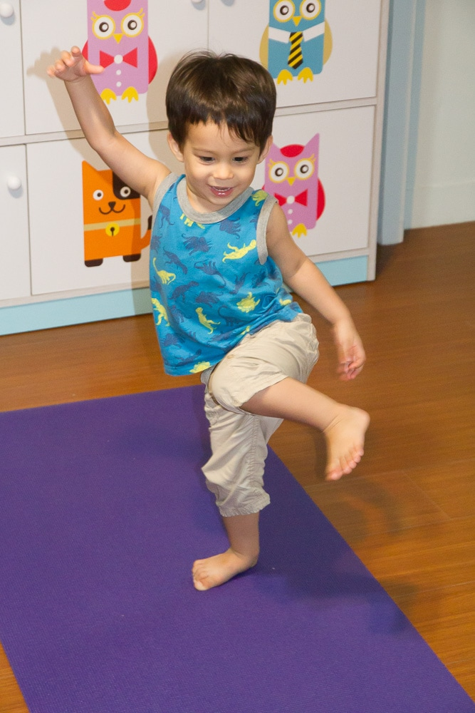 My toddler son doing animal yoga poses