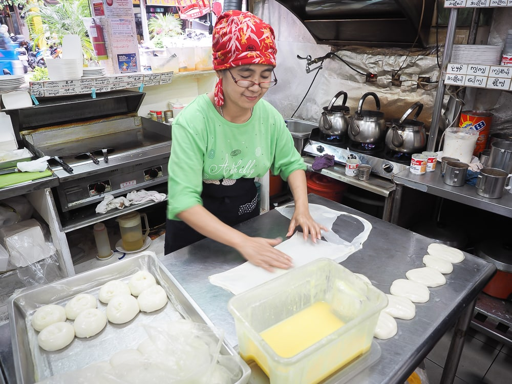 A burmese woman makes parathas on Burma Street (Myanmar Street), Zhonghe, New Taipei City