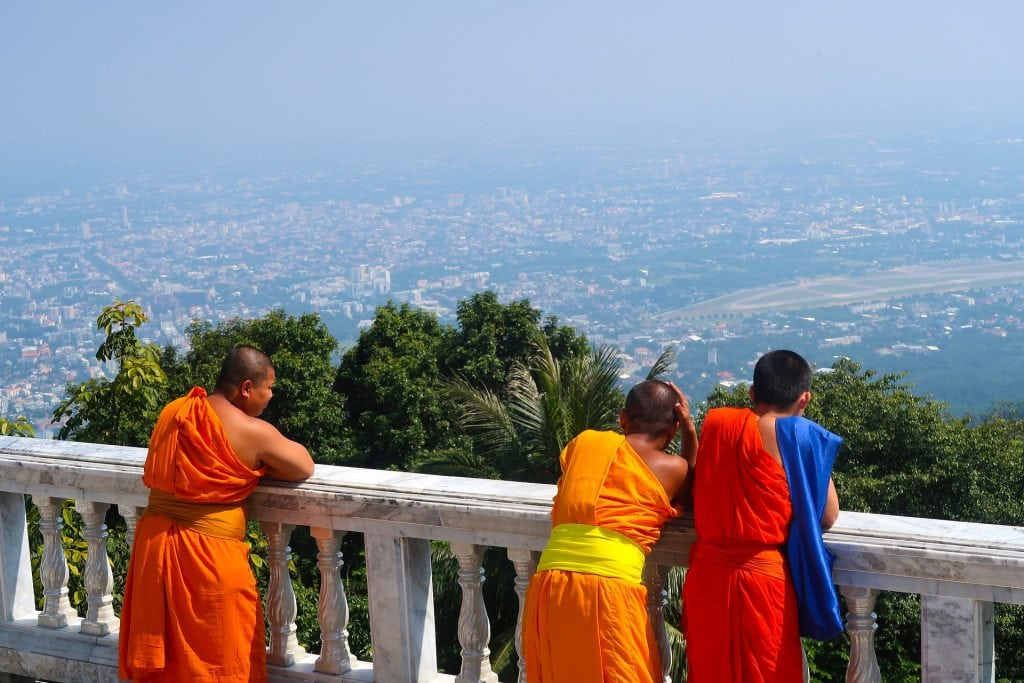Monks looking down on Chiang Mai from Doi Suthep Temple