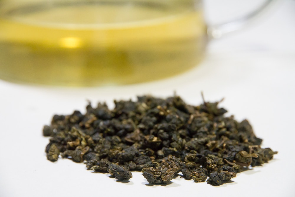 brewed dong ding tea and tea leaves