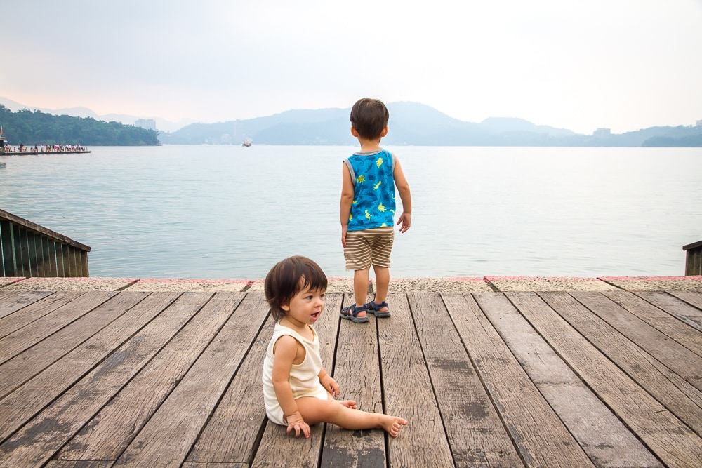 Playing on the docks at Itathao, Sun Moon Lake