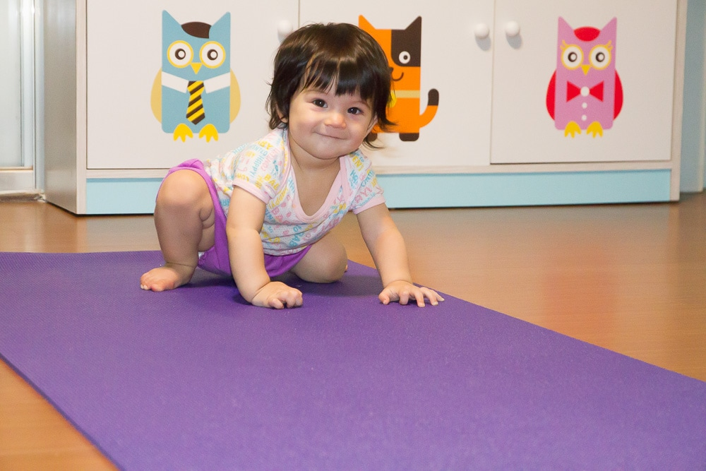 My daughter getting used to the yoga mat