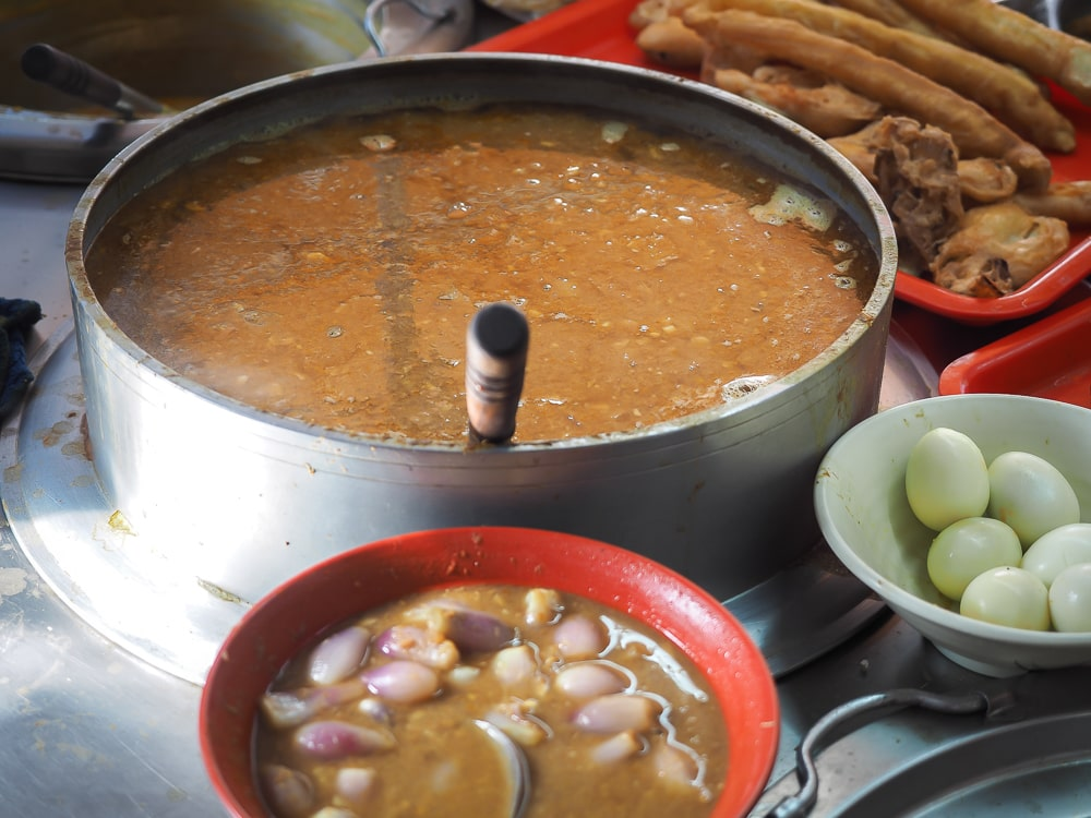 A huge pot of catfish curry used for making mohinga, the national dish of Myanmar