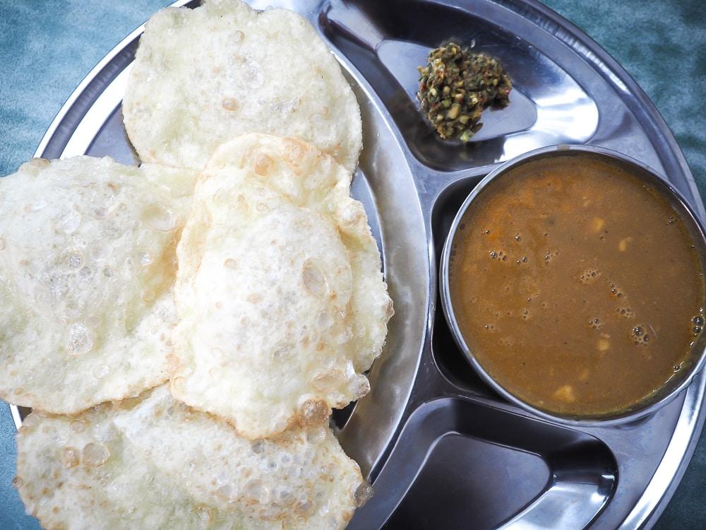 Potato flour cakes and potato curry on Burma Street