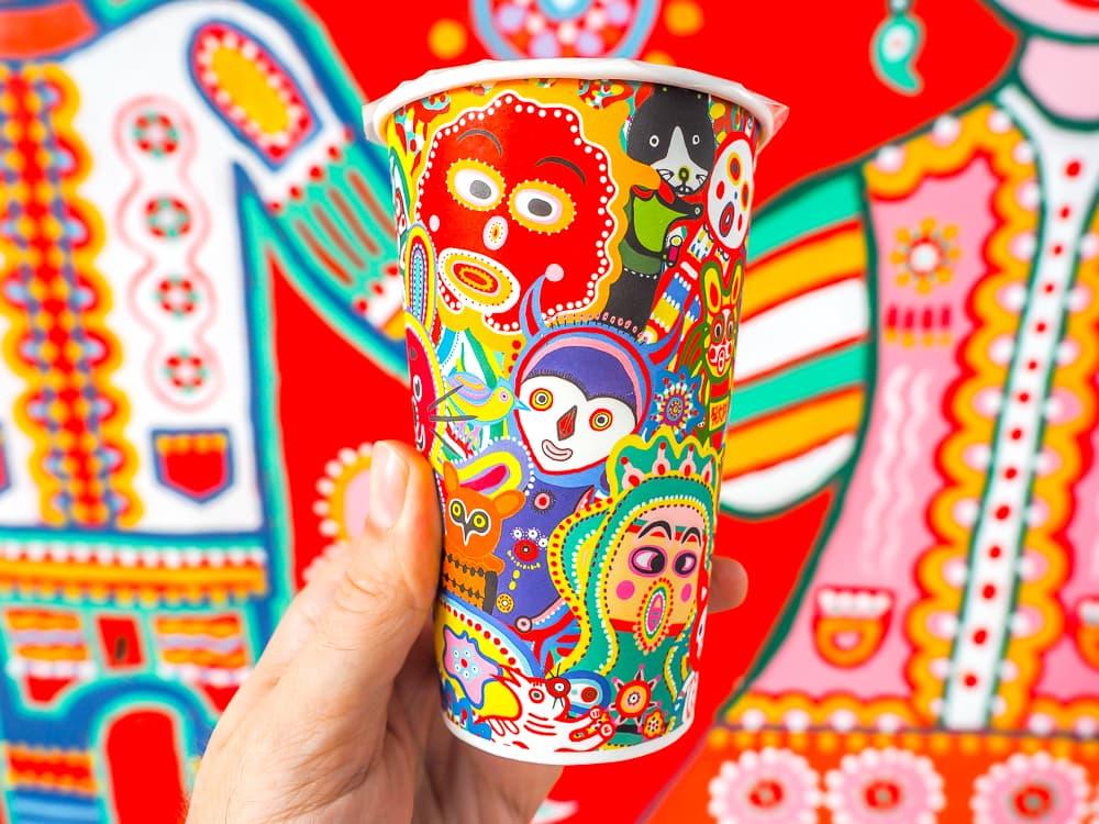 Rainbow Village coffee cup