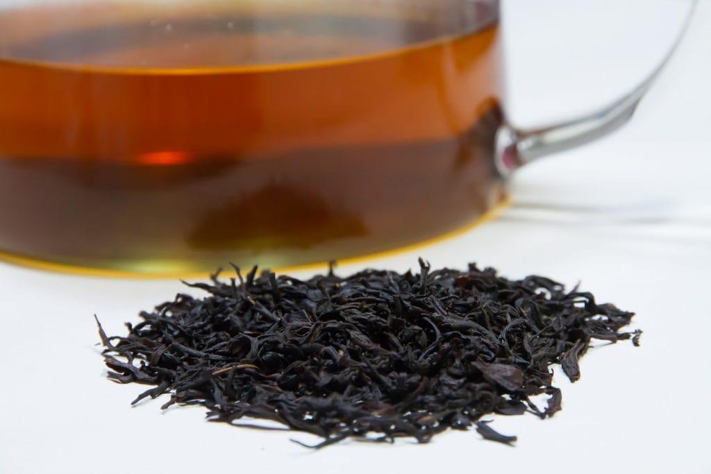 Brewed Ruby Red black tea and tealeaves