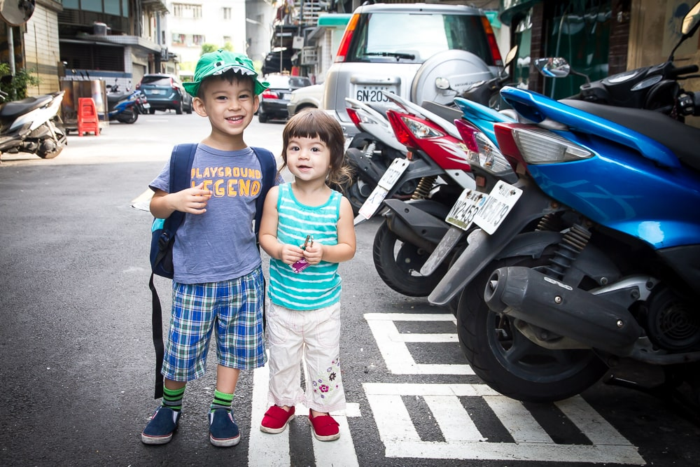 My kids Sage and Lavender in front of our home in New Taipei, Taiwan