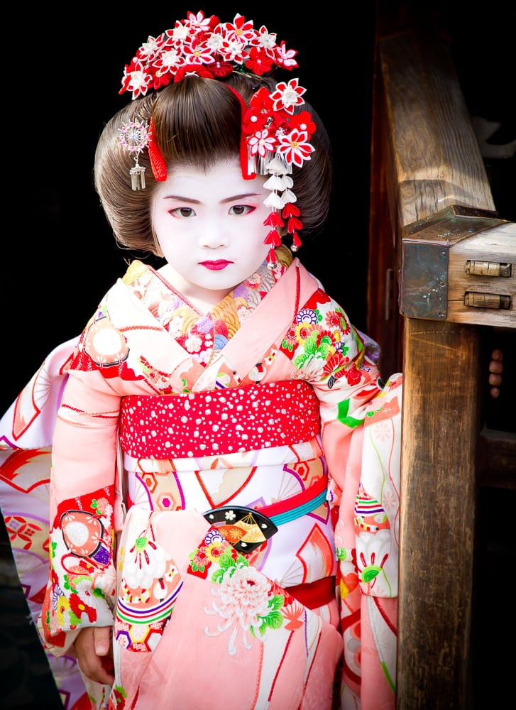 Young Asian girl dressed as a Japanese geisha in Kyoto, Japan