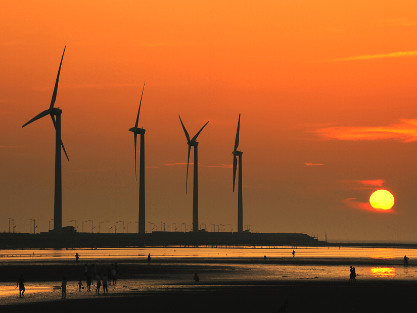 Wind turbines and sunset at Gaomei Wetlands