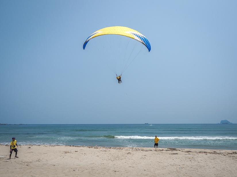 People paragliding on Wanli Beach, Taiwan