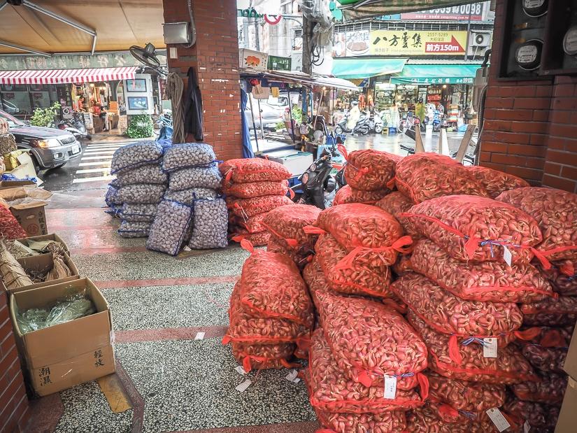 Bags of shallots and garlic on Dihua Jie (Dihua Street), Dadaocheng