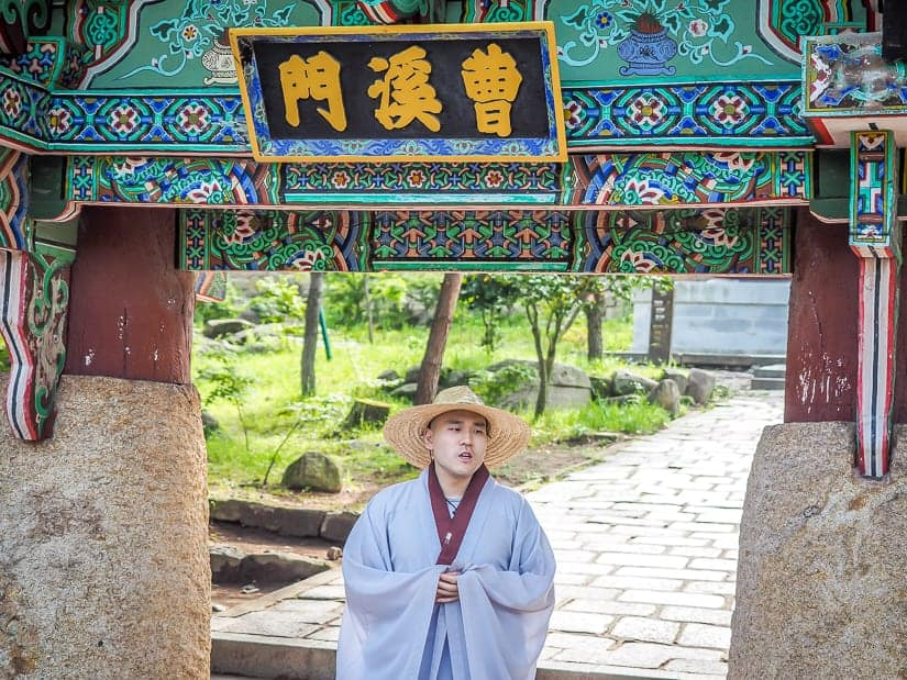 A monk at Beomeosa introducing the temple gate to use as part of the temple tour