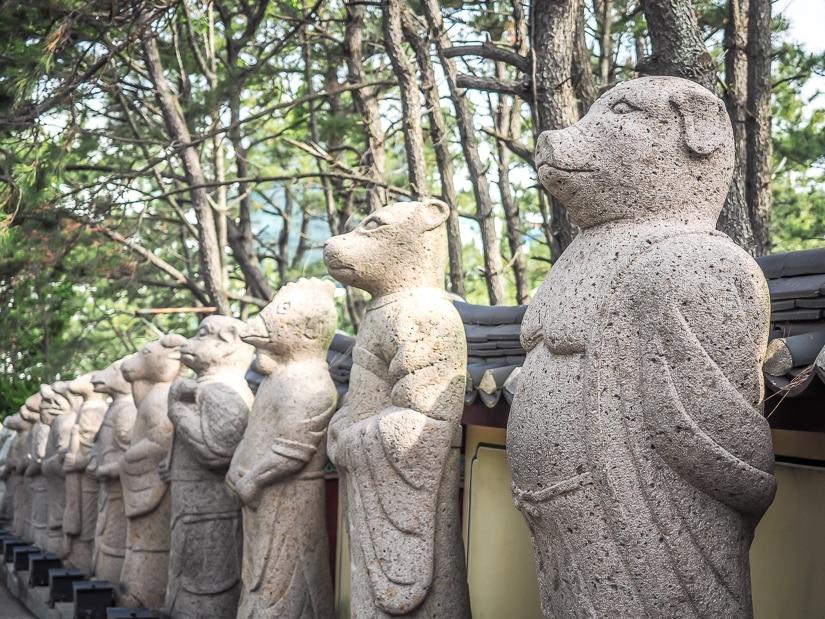 Zodiac animal statues at entrance to Haedong Yonggung Temple