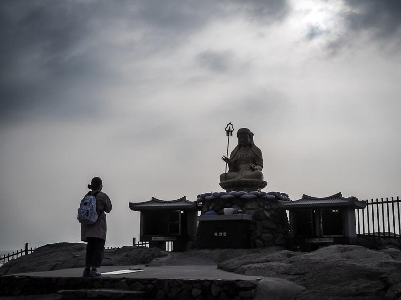 Golden statue of Jijang Bosal on the sunrise platform at Haedong Yonggungsa