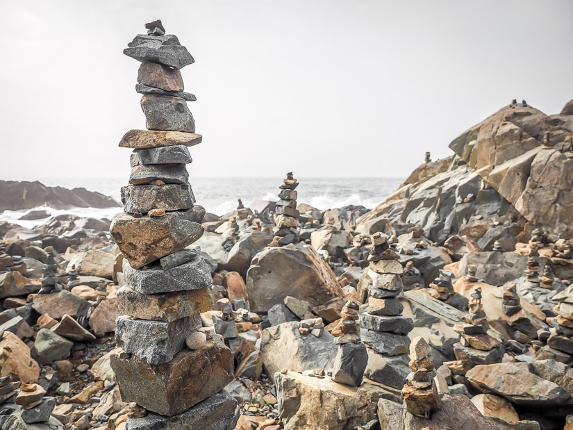 Rock people on coast near Haedong Yonggungsa