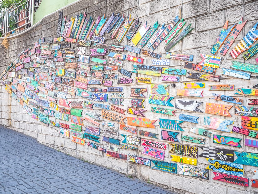 """Fish Swimming through the Alley"" artwork at Gamcheon Culture Village"