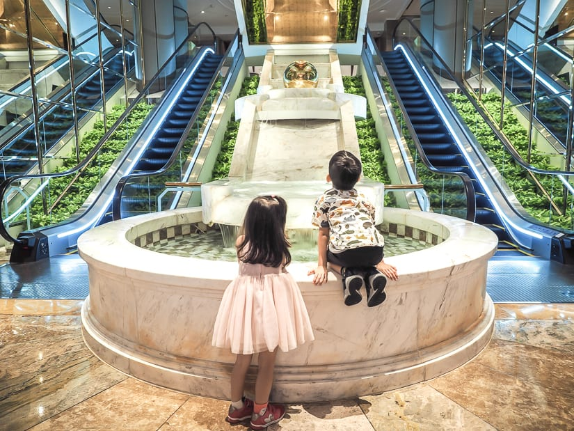 Our kids near elevators in lobby of Grand Hyatt Taipei