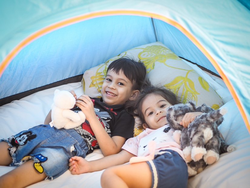 Kids in tent at Grand Hyatt luxury camping experience