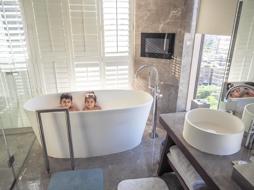 Kids in bathtub in Grand Hyatt Taipei suite