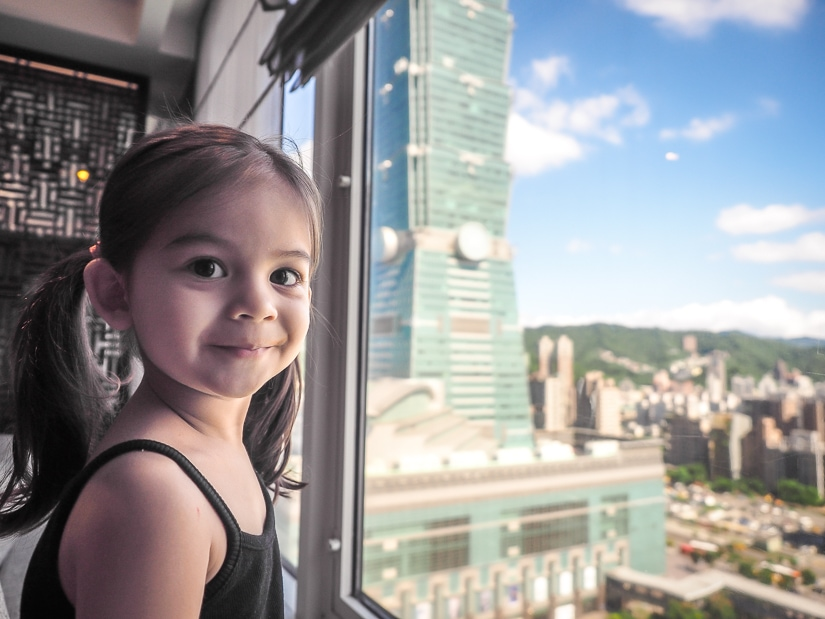 My daughter looking at Taipei 101 from the Grand Lounge at Grand Hyatt Taipei