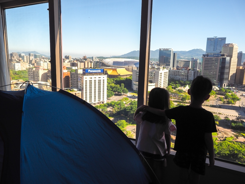 Sage and Lavender with view of Taipei from their tent at Grand Hyatt Taipei
