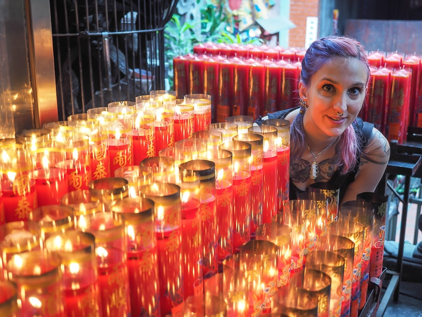 My sister with candles in Tianhou Temple, the most famous temple in Ximending