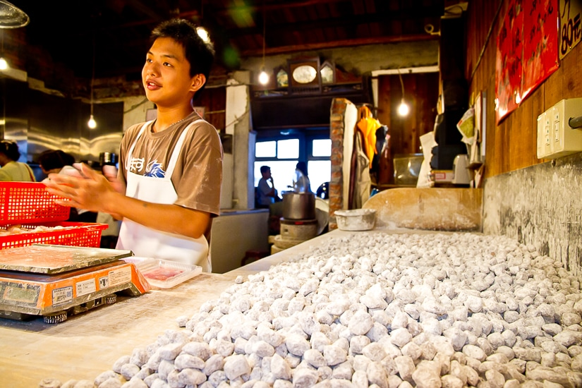 A young Taiwanese man making taro balls, one of the best foods in Jiufen