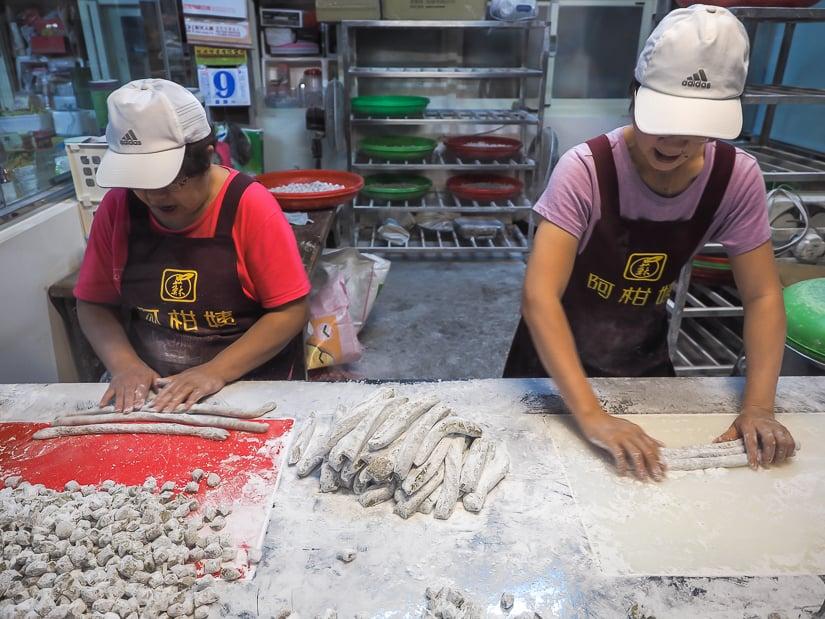 Workers preparing taro balls at Ah Gan Taro Balls, Jiufen, Taiwan