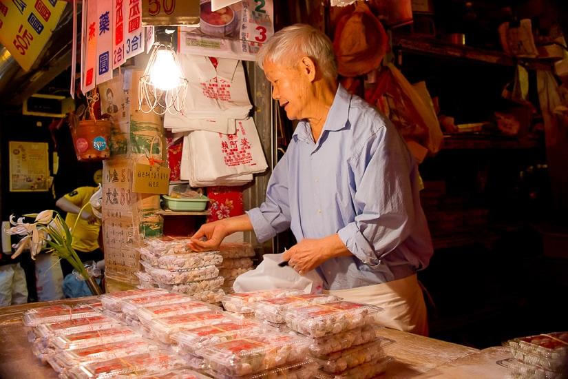 An elderly vendor at Lai Ah Po Taro Balls on Jiufen Old Street