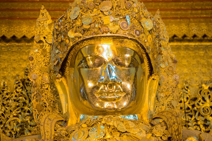 Golden Buddha statue at Mahamuni temple in Mandalay, Myanmar