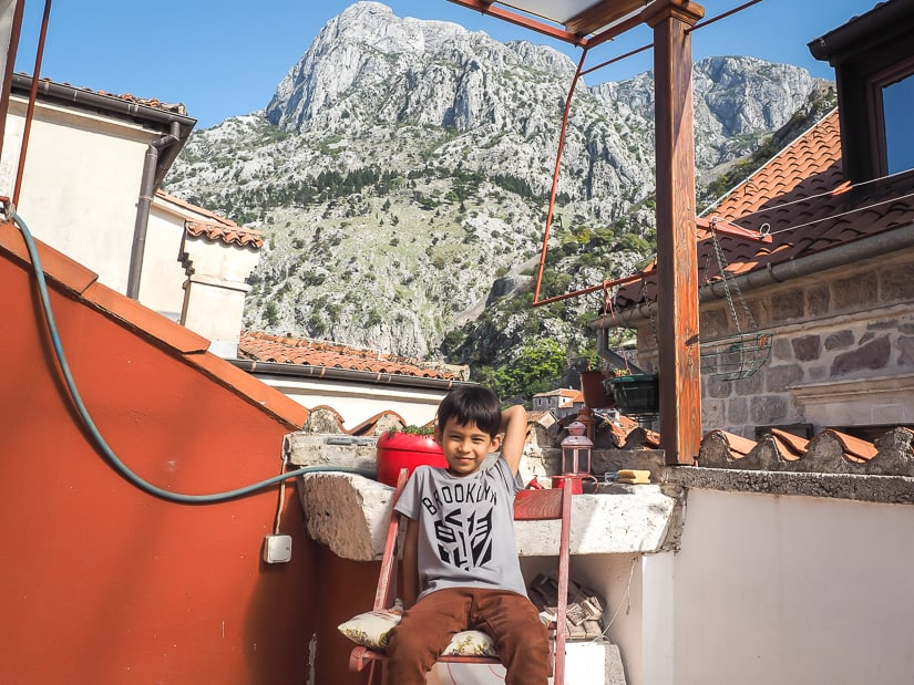 My son on the rooftop balcony of our Airbnb in Kotor