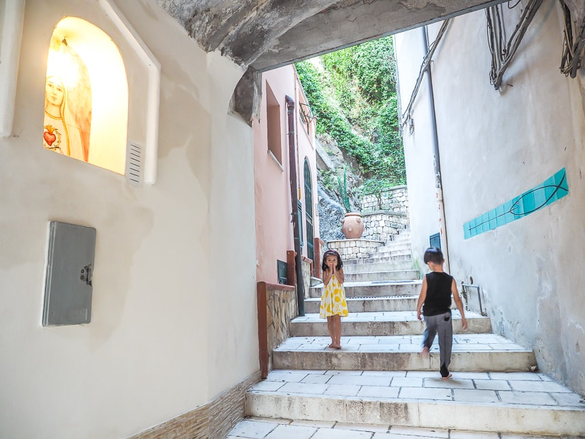 Our kids in some staircases in Amalfi Coast