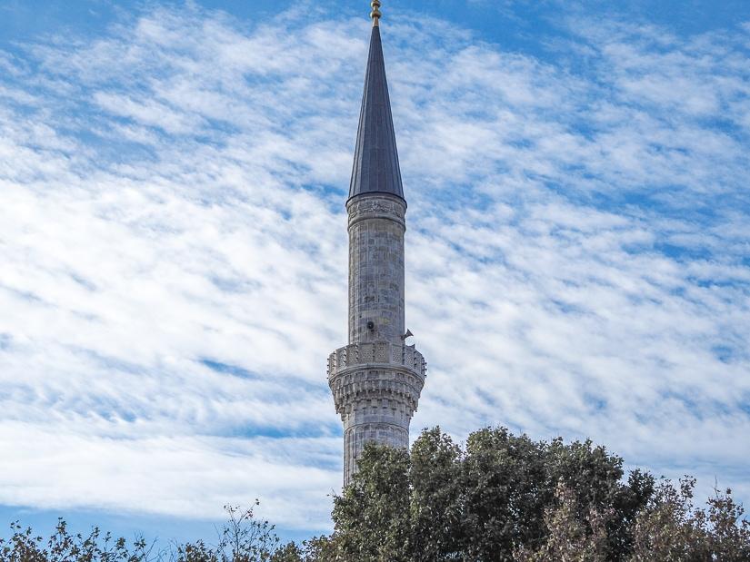 Blue Mosque minaret with a blue sky background