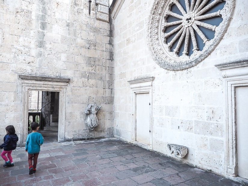 Our two kids on the second floor outdoor baclony of Kotor Cathedral
