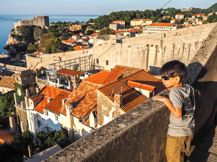 My son looking at Dubrovnik's rooftops from the norther section of the Old Town wall