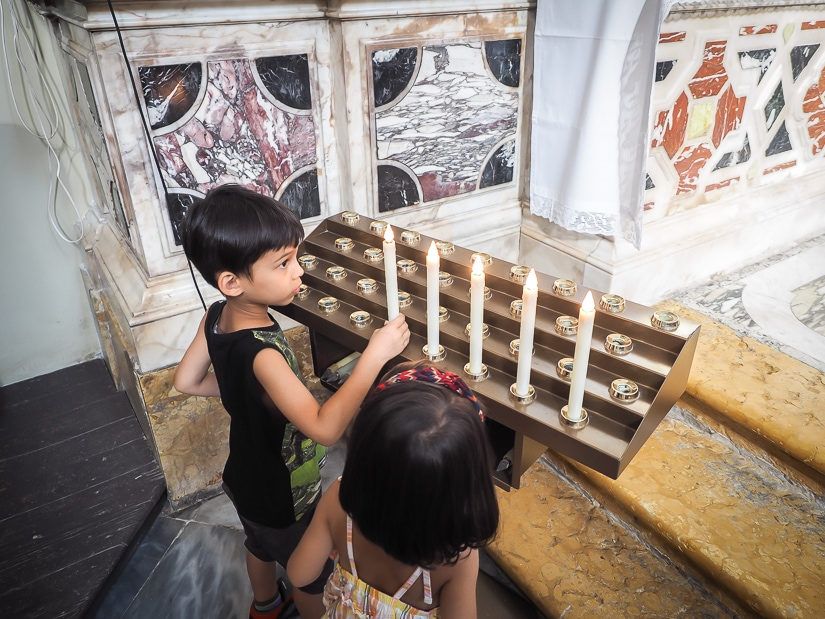 Our kids lighting candles in a Dubrovnik church