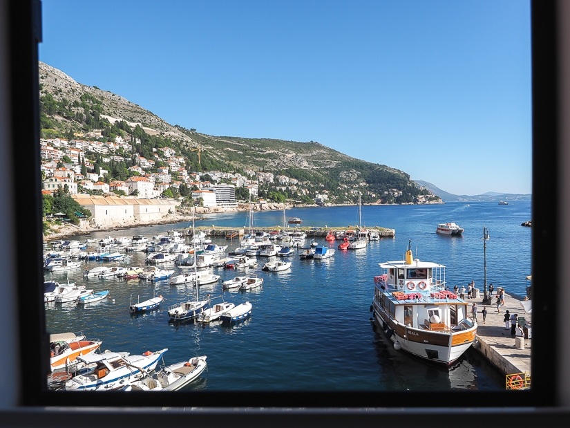 View of Dubrovnik Port and Lokrum Island ferry from window of our Dubrovnik kid-friendly hotel window