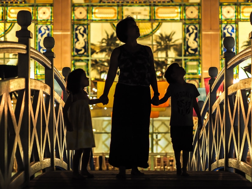 My wife and kids in front of the Grand Hyatt Muscat at night
