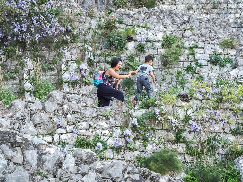My wife and kids on Old City wall hike to Saint John's Fortress in Kotor