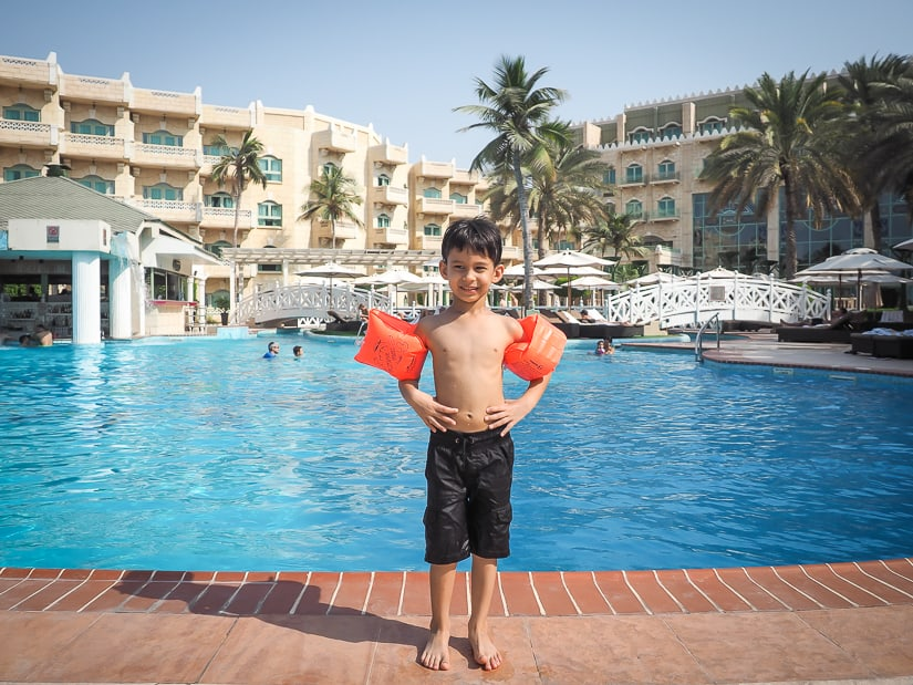 Sage in front of the swimming pool at Grand Hyatt Muscat