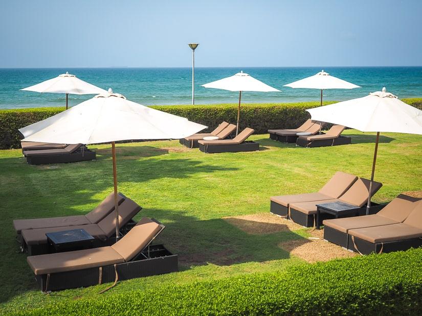 Sun chairs near beach at Grand Hyatt Muscat