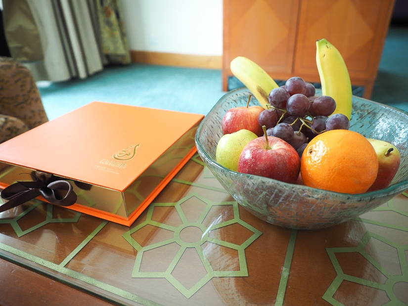 Box of chocolates and basket of fruits in our hotel room
